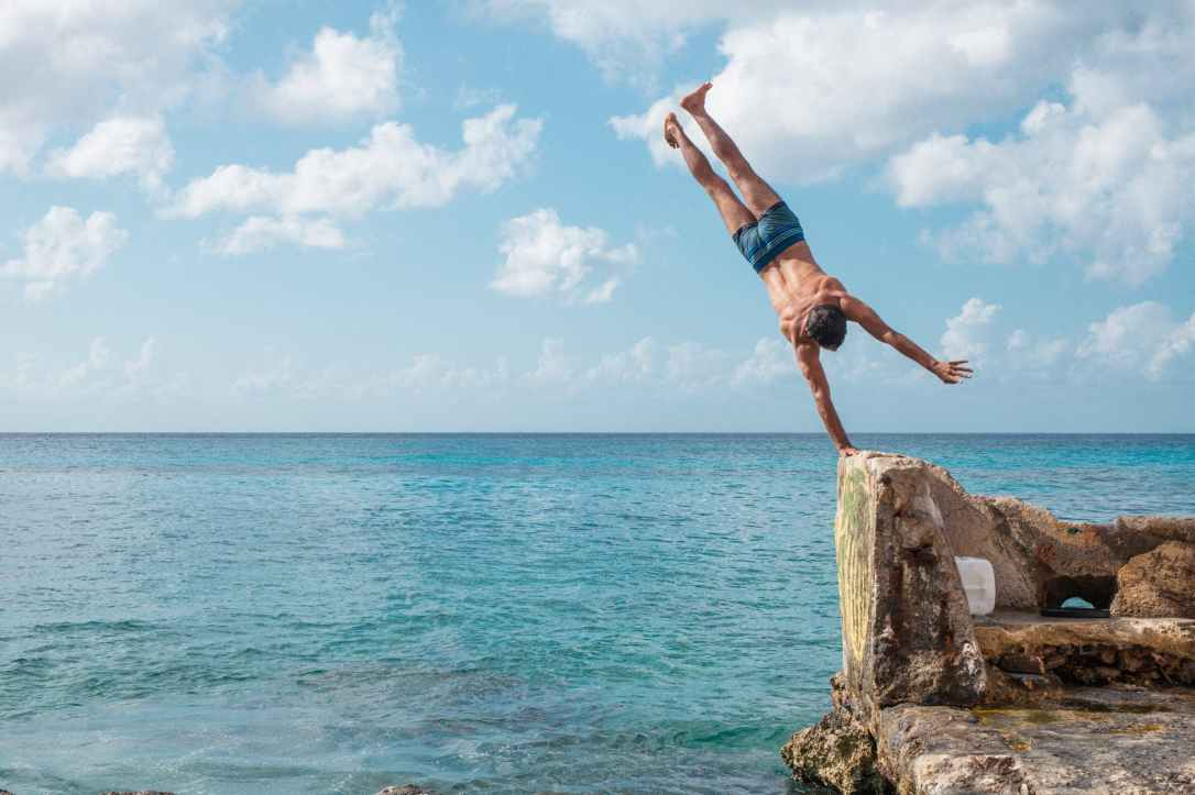 man hand standing on rock
